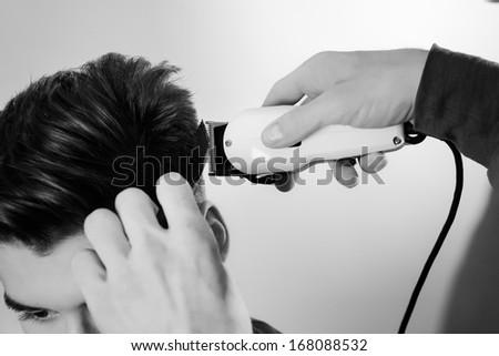 close up shot of man getting his hair cut - stock photo