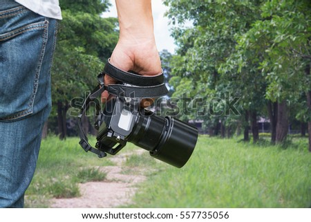 Close-up shot of man hand holding camera.