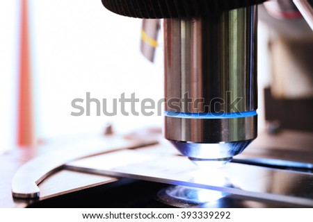 close up shot of microscope at the blood laboratory - stock photo