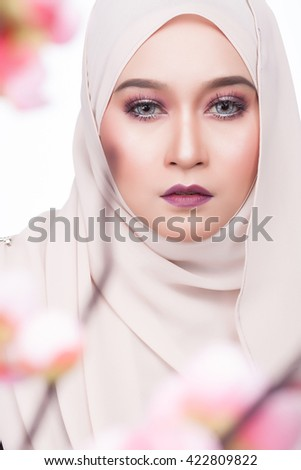 close up shot of moslem asian woman beauty fashion shoot with natural expression and make up - stock photo