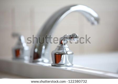 Close up shot of nice tub faucet - stock photo