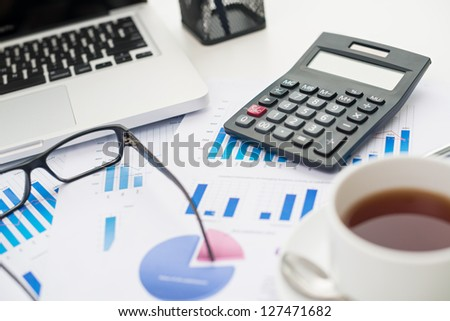 Close-up shot of office objects and statistical documents - stock photo