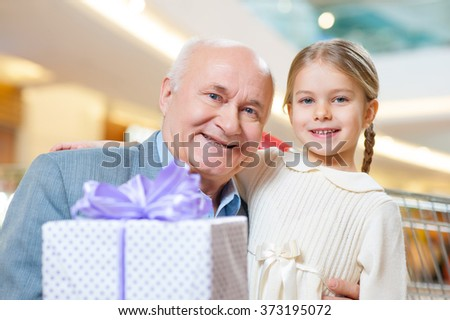 Close-up shot of old grandfather with adorable grandkid - stock photo