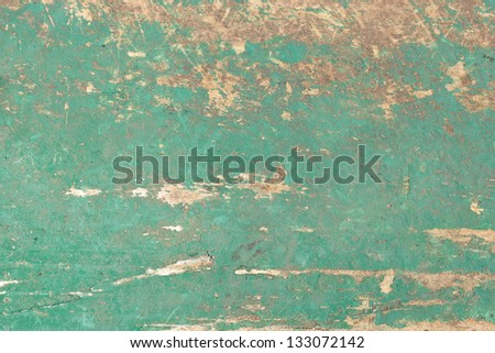 close up shot of old green paint texture peeling off wood plank background - stock photo
