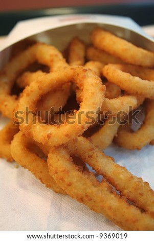 Close up shot of onion rings, the popular fast food snack. - stock photo