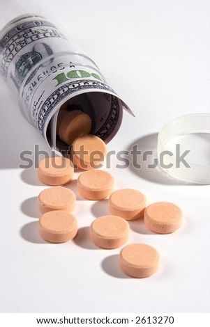 Close up shot of pills and US dollar. - stock photo