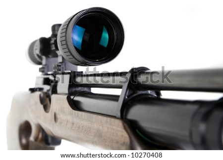 Close-up Shot of Precision Lens Scope on Snipers Rifle