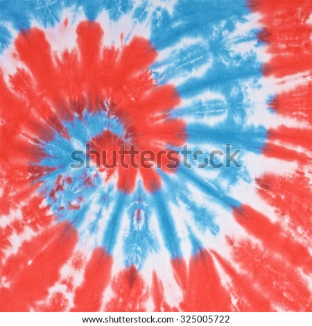 close up shot of red, white and light blue color tie dye fabric texture background in square ratio - stock photo