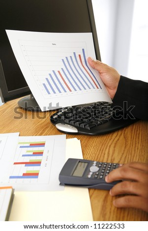 close up shot of sales figure and a pair hand of business man