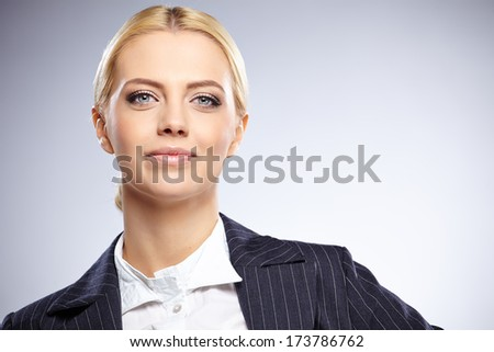 Close up shot of smiling young businesswoman isolated - stock photo
