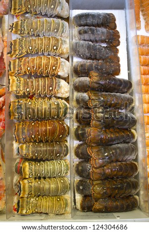 Close-up shot of stack of large group of lobsters. - stock photo