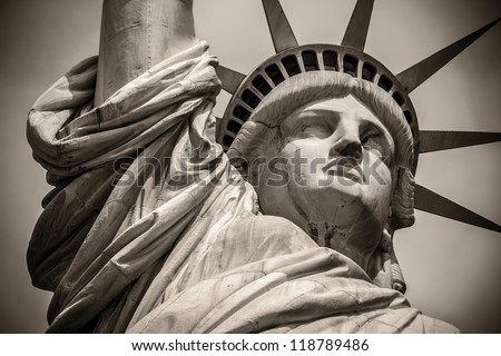 Close-up shot of the Statue of Liberty in black and white. - stock photo