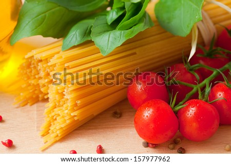Close up shot of the traditional ingredients of Italian cuisine - stock photo
