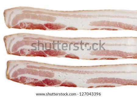 Close-up shot of three sliced bacon isolated on white background. - stock photo