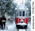 close up shot of tramway covered with snow in istanbul - stock photo