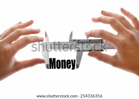 "Close up shot of two hands holding a caliper and measuring the word ""Money"" - stock photo"