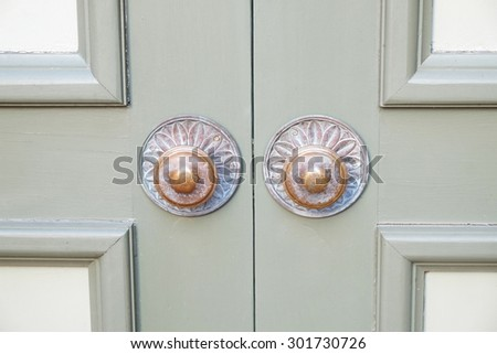 Close up shot of two old style door knobs - stock photo