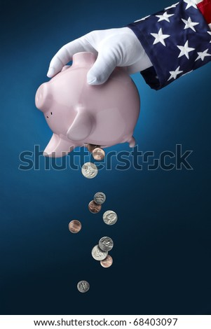 Close up shot of Uncle Sam emptying out coins from pink Piggy Bank - stock photo