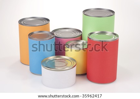 Close up shot of various tin cans with plain colored labels - stock photo