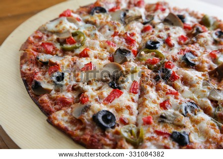 Close up shot of vegetable cheesy flat bread pizza - stock photo