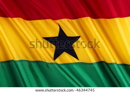 Close up shot of wavy, colorful flag of Ghana - stock photo
