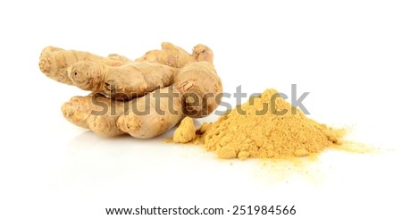 Close-up shot of whole ginger with spice isolated on white background - stock photo