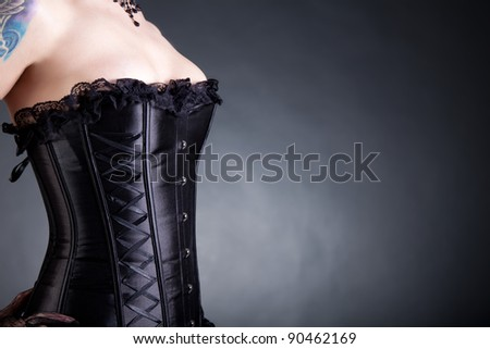 Close-up shot of woman in black corset, copy-space for your text - stock photo
