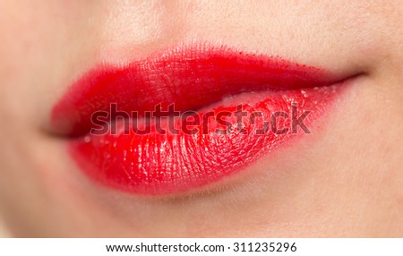 Close-up shot of woman lips with glossy red lipstick - stock photo