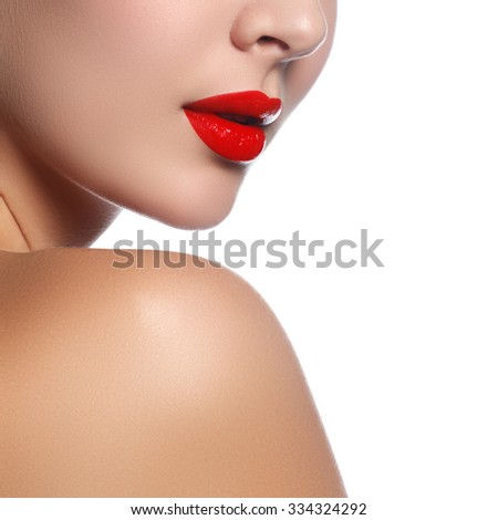 Close-up shot of woman lips with glossy red lipstick. Glamour red lips make-up, purity skin. Retro beauty style. Beautiful model girl with beauty makeup, red lips, perfect fresh skin.Skin Care Concept - stock photo