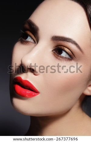 Close-up shot of woman's face with red lips and stylish make-up - stock photo