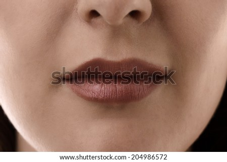 close up shot of womans lips