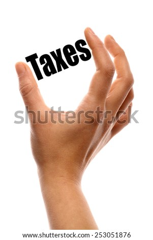 "Close up shot two fingers measuring the word ""Taxes"" - stock photo"