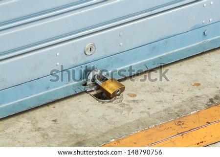 Close up shutter door with key locked of car garage - stock photo