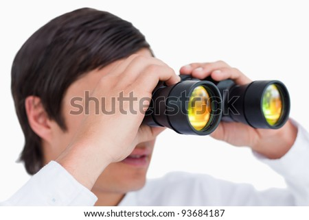 Close up side view of tradesman with spy glass against a white background - stock photo