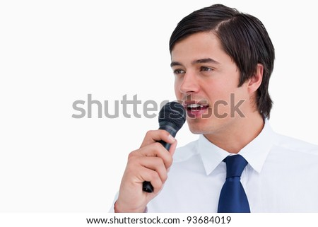 Close up side view of young tradesman with microphone against a white background