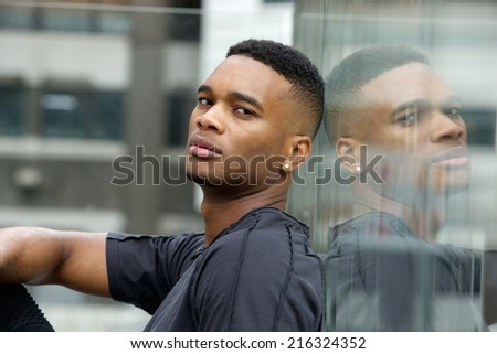 Close up side view portrait of a cool black guy - stock photo