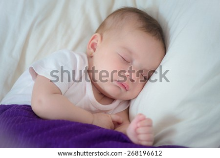close-up sleeping baby on white - stock photo