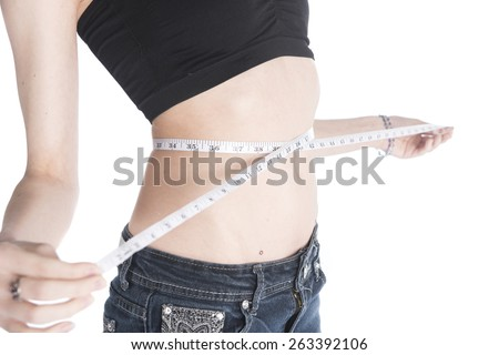 Close up Slender Woman Measuring her Waist Line Using Tape Measure, Isolated on White Background. - stock photo