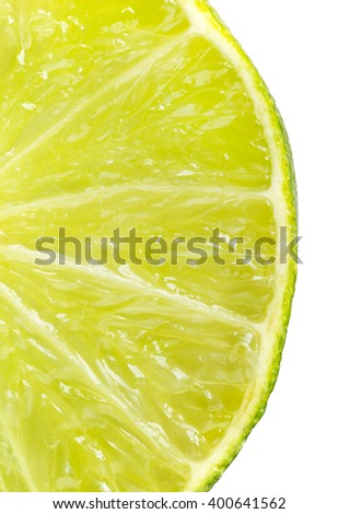 Close up slice of fresh lime on white - stock photo