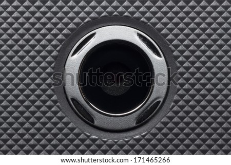 close-up smartphone camera lens on carbon filter texture - stock photo