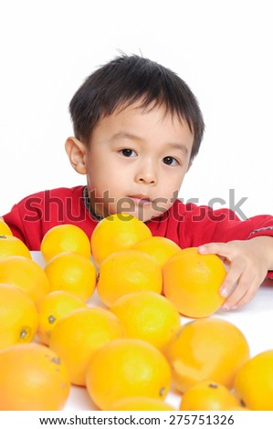 Close up Smile boy with oranges - stock photo