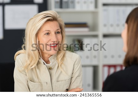 Close up Smiling Blond Attractive Office Woman Talking to her Assistant Employee at her Office. - stock photo