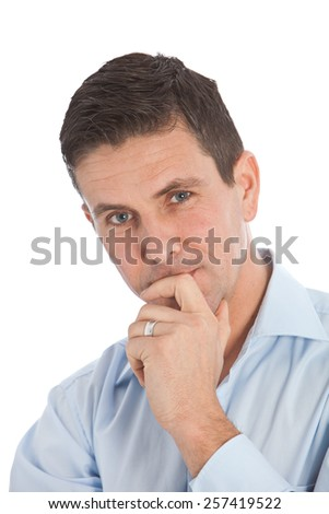 Close up Smiling Young Handsome Businessman, with Hand on his Chin and Lips, Looking at the Camera on a White Background. - stock photo