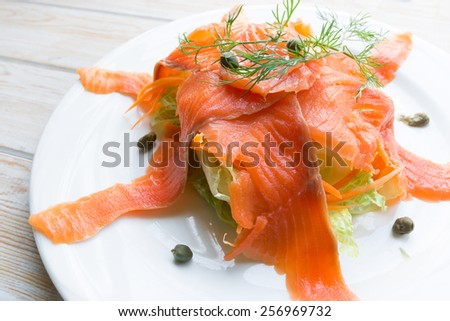 Close up smoked salmon on white dish  - stock photo