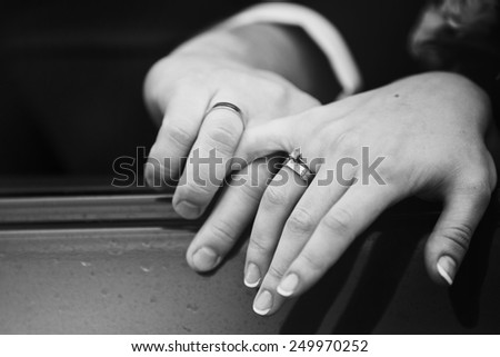 Close up snapshot of a husband lovingly holding his wife's hand. - stock photo