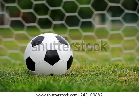 Close-up soccer ball on green grass - stock photo