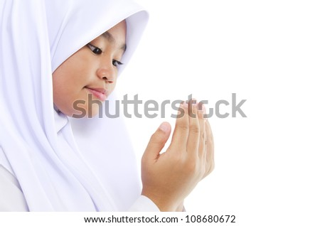 Close up Southeast Asian youth Muslim prayer is praying over white background - stock photo