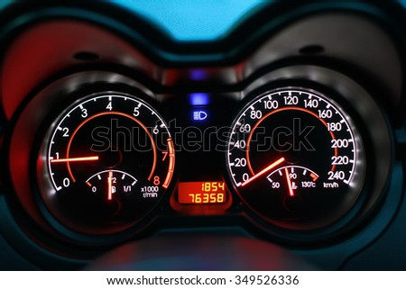 Close up Speedometer of a car with high lamp on - stock photo