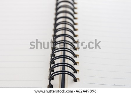 Close up spiral note book.