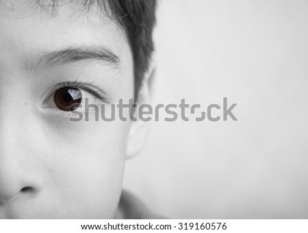 Close up spot color eyes of boy black and white  - stock photo